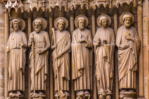 Fotografia, Obraz Biblical Saint Statues Door Notre Dame Cathedral Paris France