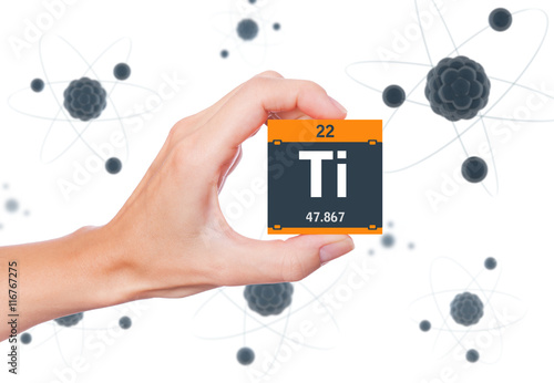 Titanium Element Symbol Handheld And Atoms Floating In Background