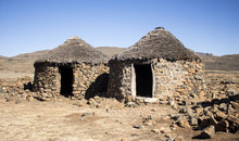 Traditional Ethnic African Houses Rondavels Made From Stones And Clay. Abandoned Village.