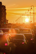 Cars are in traffic jam during a beautiful golden sunset.