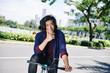 Joyful young man enjoying cycling in the city