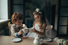 Boy And Girl Having Tea Party ...