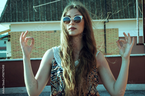 Fashion portrait outdoor with a beautiful girl with sunglasses and an old vintag Canvas Print