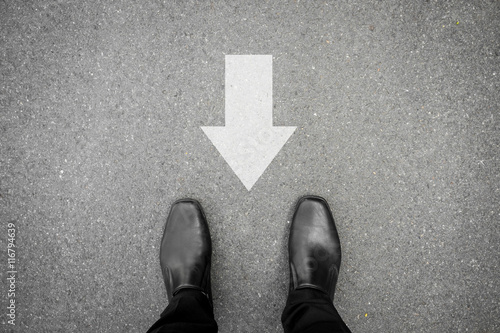 Black shoes and direction sign backward Canvas Print