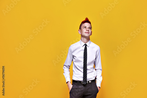Portrait of displeased teen punk in shirt and tie looking away with hands in pockets Canvas Print