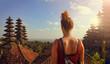 canvas print picture - Junge Frau in einer Tempelanlage auf Bali (Besakih Tempel)