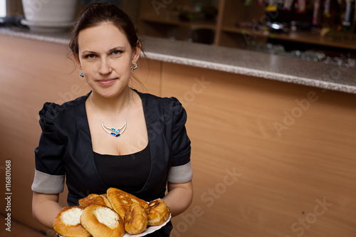 young woman with traditional russian cakes - Buy this stock