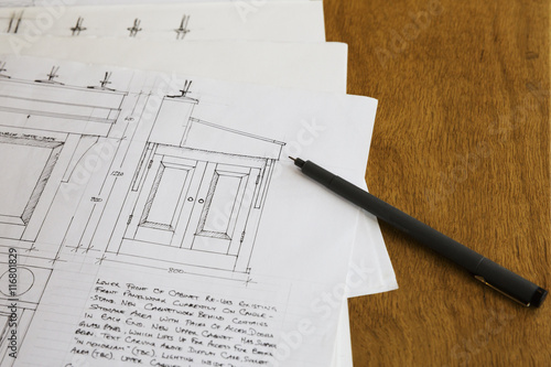 Close up of design drawings for a cabinet, handwritten notes.