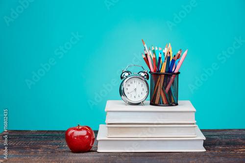Fotografia  Back to School concept. Books, colored pencils and clock