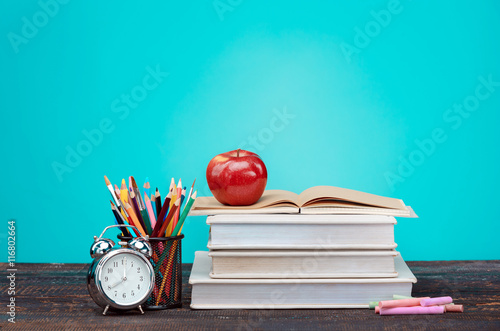 Stampa su Tela  Back to School concept. Books, colored pencils and clock