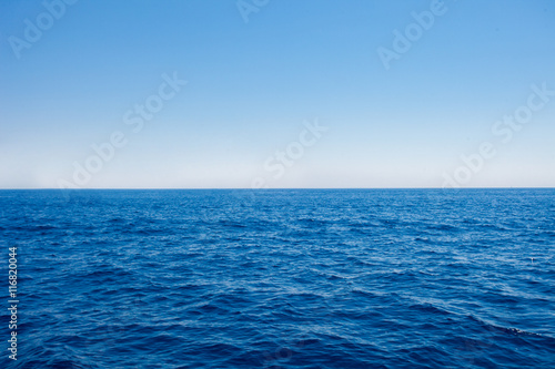 Fotobehang Zee / Oceaan Background of sparkling sea water on a bright sunny day. Sea and sky