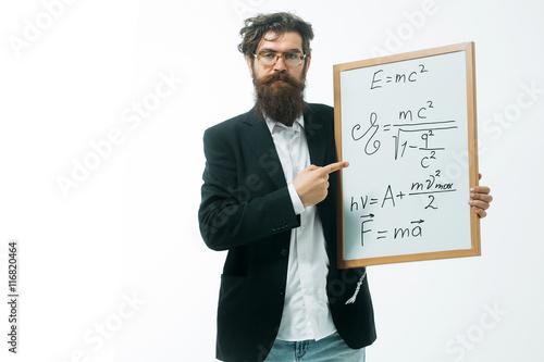 фотография  bearded man with einstein formula and newtons law