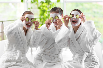 Beautiful girls with masks in spa salon