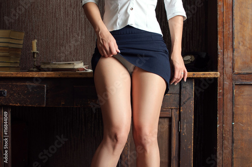 in an office style girl lifted her skirt and showing white panti Canvas Print