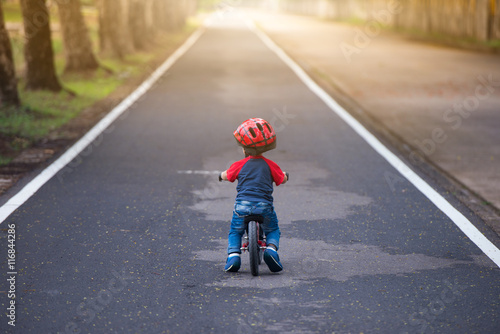 Fotografia 2 years old boy play with bicycle, balance bike