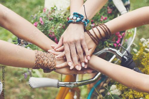 Fotografía  United hands of girlfriends closeup, young girls in boho bracelets