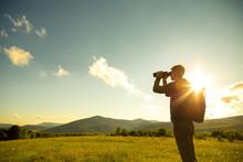 Young Man Use Of The Binocular...