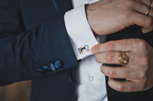 Putting On The Cufflinks On The Cuff Of His Shirt 6408.