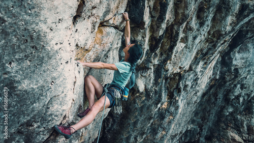 Woman with outfit climbing the rock