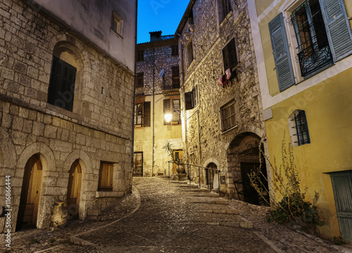 Canvas Prints Narrow alley Narrow cobbled street in old town Peille at night, France.