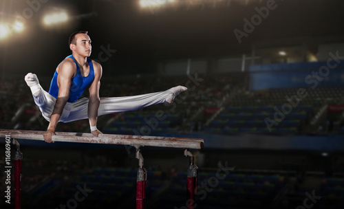 Photo Stands Gymnastics portrait of young man gymnasts