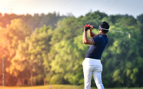 Leinwand Poster Golfer hitting golf shot with club on course vintage color tone
