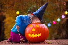 Kids Carving Pumpkin At Hallow...