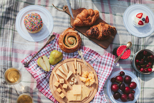 Spoed Foto op Canvas Picknick summer picnic on the rug. Fruits, berries, pastries and cheese