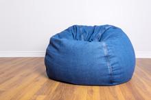 Denim Beanbag Resting On Laminated Flooring