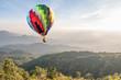Colorful hot air balloon over mountain