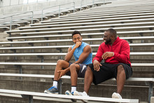 Coach Spending Time Mentoring ...