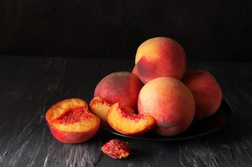 Fototapeta na wymiar Peaches on black