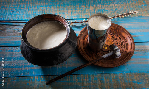 Fotografie, Obraz  Indian sweet Lassi made up of milk, curd, sugar and salt mixed with ice cubes, s