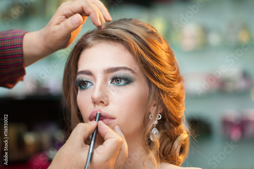 Poster  Pretty girl making makeup