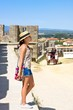 Girl in straw hat on tour in Carcassonne