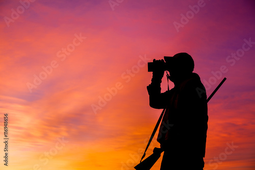 Foto op Canvas Jacht Rifle Hunter Silhouetted at Sunrise