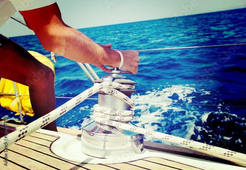 Sailing crew member pulling rope on sailboat Poster Mural XXL