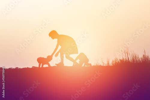 Canvas Prints Horses Silhouettes of mather and little daughter walking at sunset