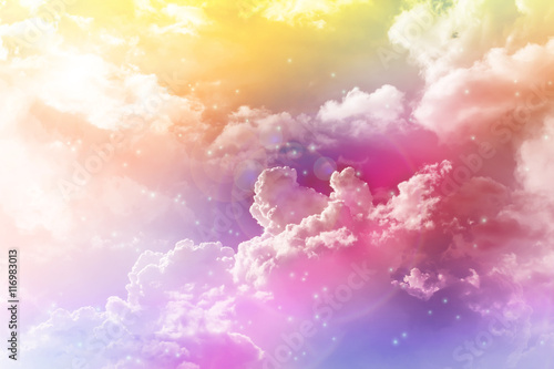 Fotomural Colourful dreamy puffy clouds sky with lense flare