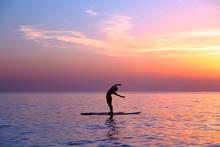 Doing Yoga Asanas On The Beach