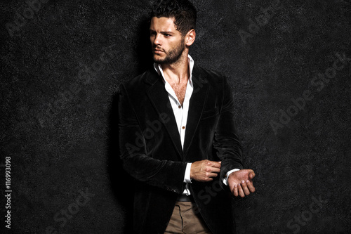 Fotografie, Obraz  Handsome man posing, night life.