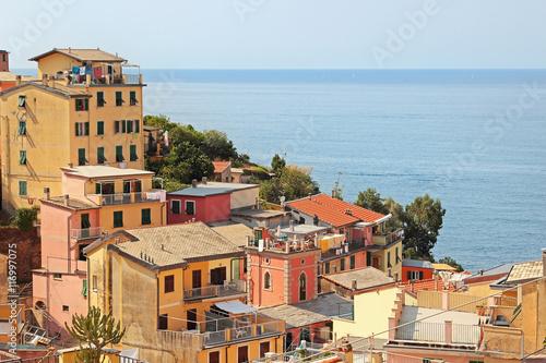 Montage in der Fensternische Ligurien View of the old village of Riomaggiore above the sea, Cinque Terre, Italy.