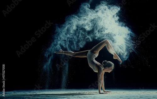 Poster Dance School Graceful woman dancing in cloud of dust