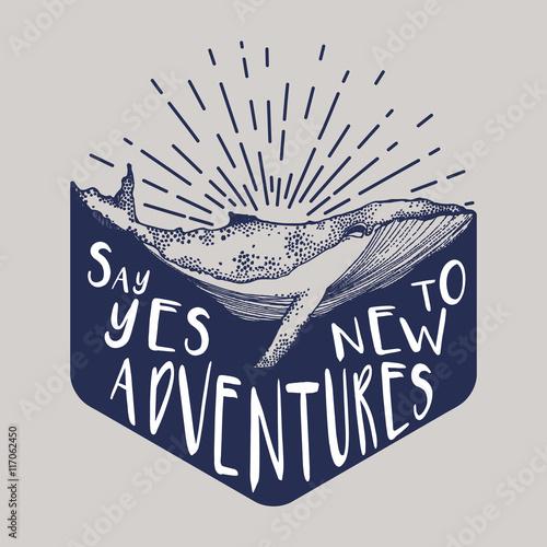 wieloryb-w-wodzie-z-napisem-say-yes-to-new-adventures