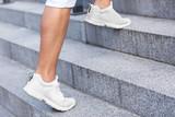 Fototapeta  - Young man running on stairs