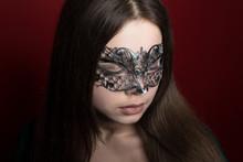 A Girl In A Venetian Mask