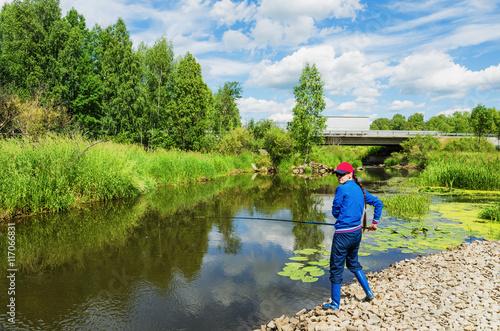 Fotobehang Vissen Woman on summer fishing
