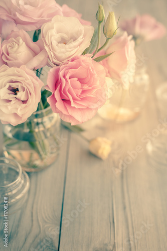 Foto op Plexiglas Retro Bouquet of beautiful pink flowers on old wooden texture