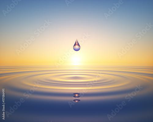 Fotografía  Wassertropfen im Ozean im Sonnenuntergang