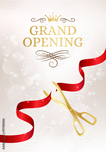 Fotografía  Grand opening banner with cut red ribbon and gold scissors.